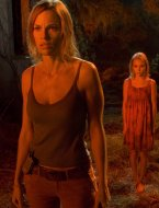 Hilary Swank and Friend face THE REAPING